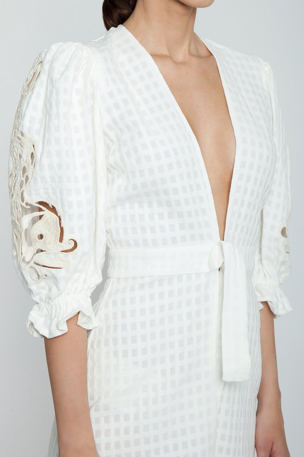 ADRIANA DEGREAS Embroidery Romper - Off White Romper | Off White| Adriana Degreas Embroidery Romper - Off White  Long sleeve romper Plunging neckline Embroidered long sleeve detail  Front tie detail  Detail View