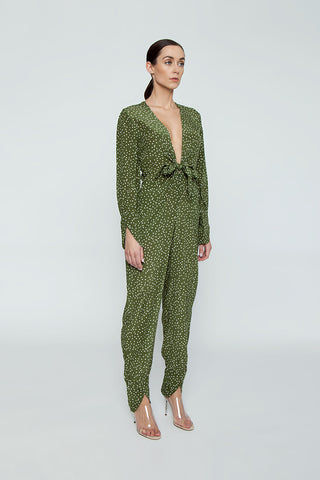 ADRIANA DEGREAS Silk Crepe De Chine Jumpsuit - Mille Punti Green Dot Print Jumpsuit | Mille Punti Green Dot Print| Adriana Degreas Silk Crepe De Chine Jumpsuit - Mille Punti Green Dot Print. Features:  Plunging v neckline Ties at front Long sleeves Main: 100% Silk.   Side View