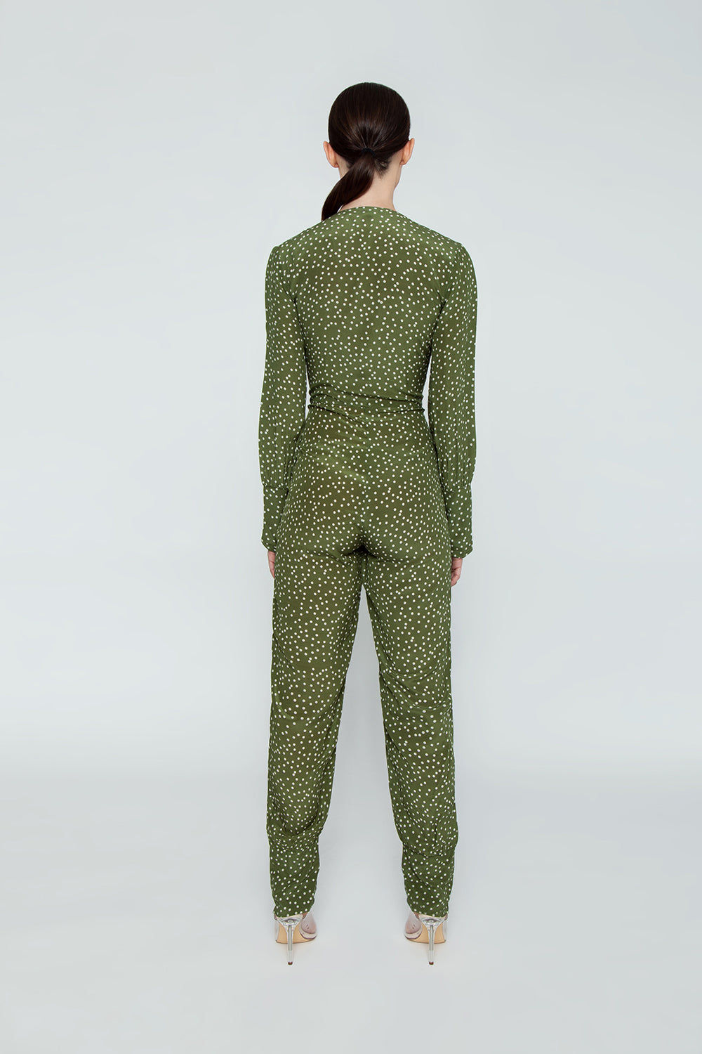 ADRIANA DEGREAS Silk Crepe De Chine Jumpsuit - Mille Punti Green Dot Print Jumpsuit | Mille Punti Green Dot Print| Adriana Degreas Silk Crepe De Chine Jumpsuit - Mille Punti Green Dot Print. Features:  Plunging v neckline Ties at front Long sleeves Main: 100% Silk.   Back View