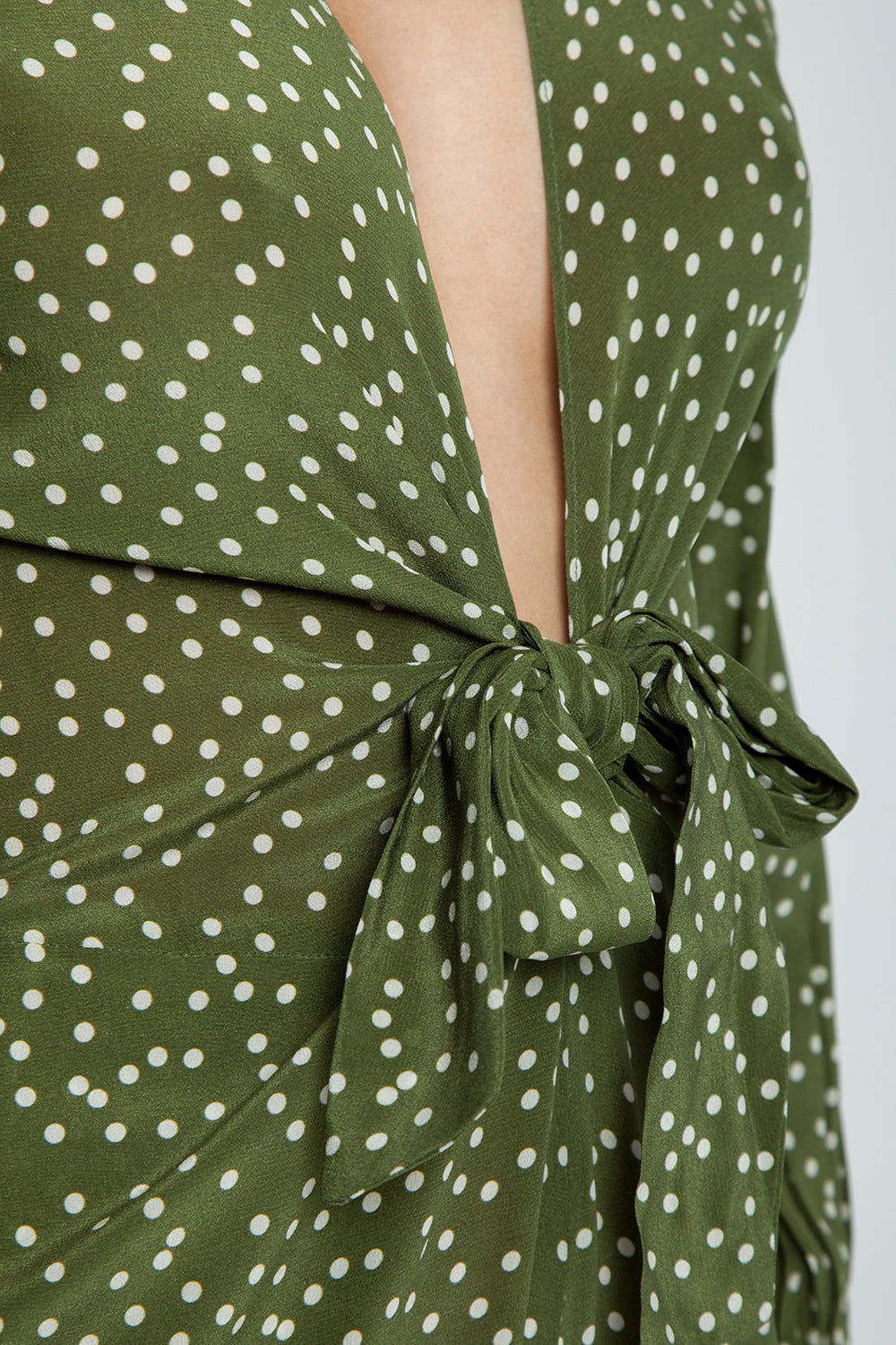 ADRIANA DEGREAS Silk Crepe De Chine Jumpsuit - Mille Punti Green Dot Print Jumpsuit | Mille Punti Green Dot Print| Adriana Degreas Silk Crepe De Chine Jumpsuit - Mille Punti Green Dot Print. Features:  Plunging v neckline Ties at front Long sleeves Main: 100% Silk.   Detail View