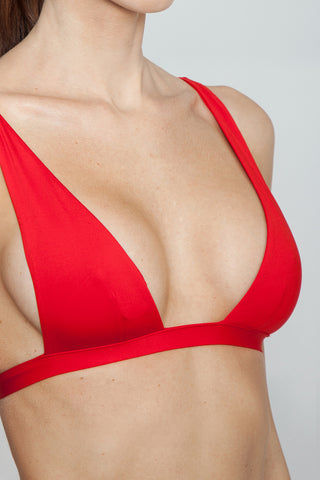 MONICA HANSEN BEACHWEAR Babe Watch Long Triangle Bikini Top - Red Bikini Top |  Red| Monica Hansen Babe Watch Long Triangle Bikini Top - Red. Features:  Small nickel colored metal clasp in black Double fabric on the inside instead of lining Italian fabric 85% Nylon 15% Elastane Manufactured in Italy Hand wash cold.  Dry Flat Detail View