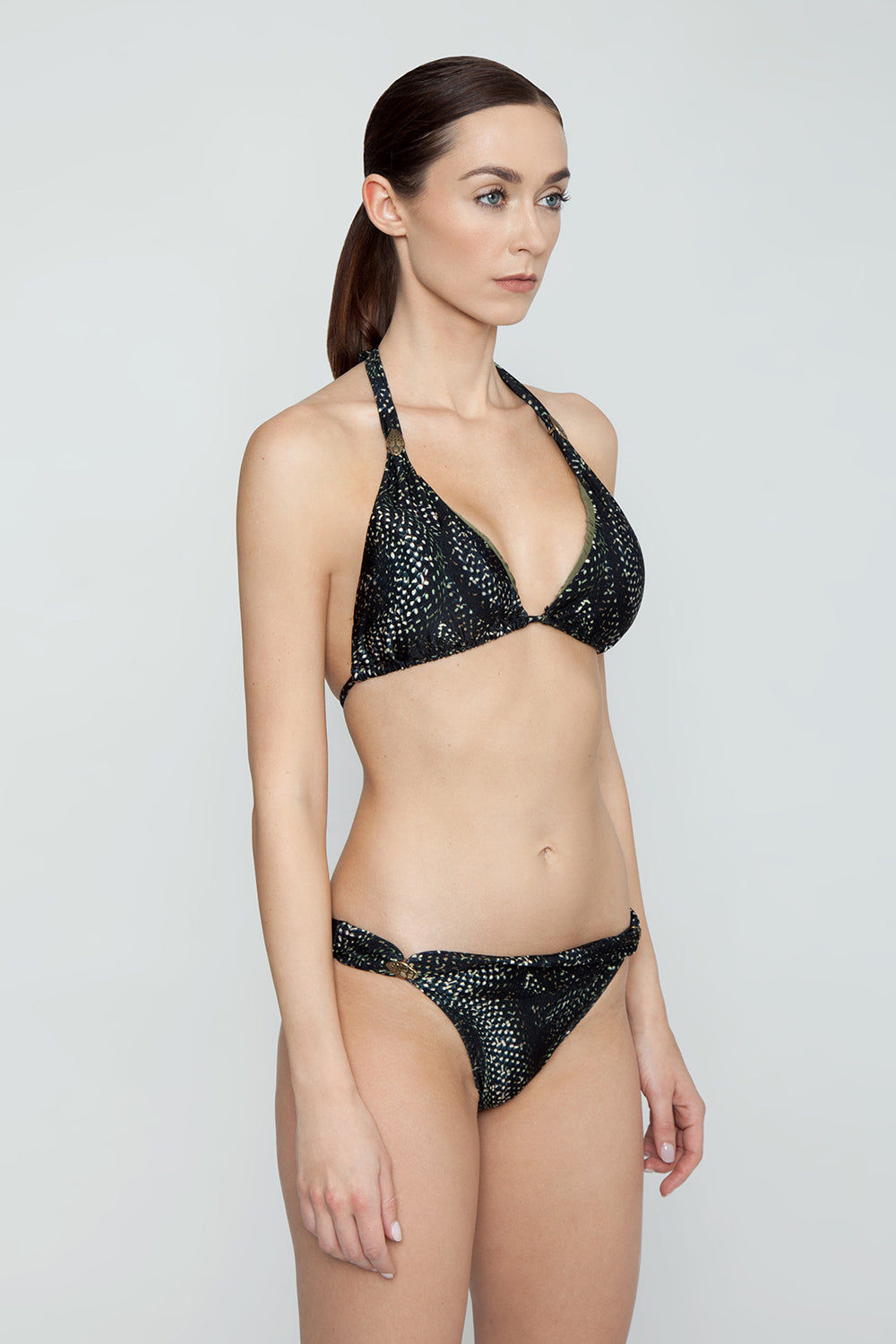 ROSA CHA Carla Strappy Bikini Top - Snake Print Bikini Top | Snake Print| Rosa Cha Carla Strappy Bikini Top - Snake Print Fabulous black snake print triangle bikini top with fabric loop detail. Elegant snake printed swim fabric will have you dreaming of romantic hideaways and secret beaches on far-off shores. Fabric loop sliders on straps can be slid up for fuller coverage or scrunched down to show more skin. Thick halter straps and string tie back closure are adjustable and allow you to customize the fit of this bikini top Side View