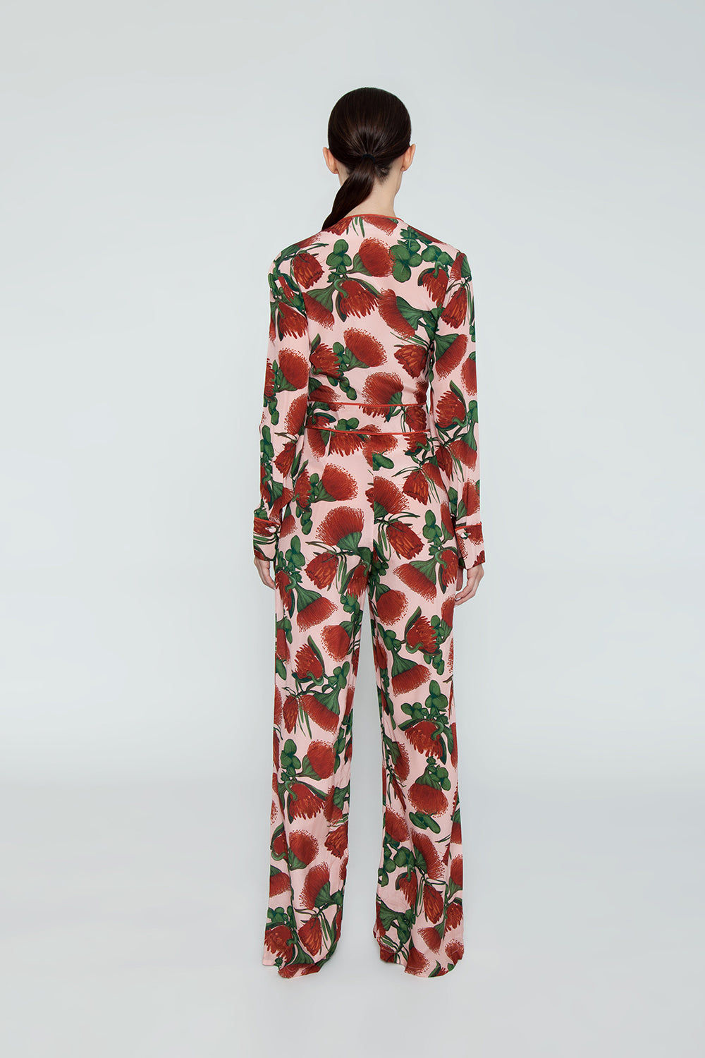 ADRIANA DEGREAS Silk Crepe De Chine Knot Detail Jumpsuit - Fiore Rose Print Jumpsuit | Fiore Rose Print|Adriana Degreas Silk Crepe De Chine Knot Detail Jumpsuit - Fiore Rose Print  Long sleeve jumpsuit Plunging neckline  Front tie detail  Wide leg pants Back View