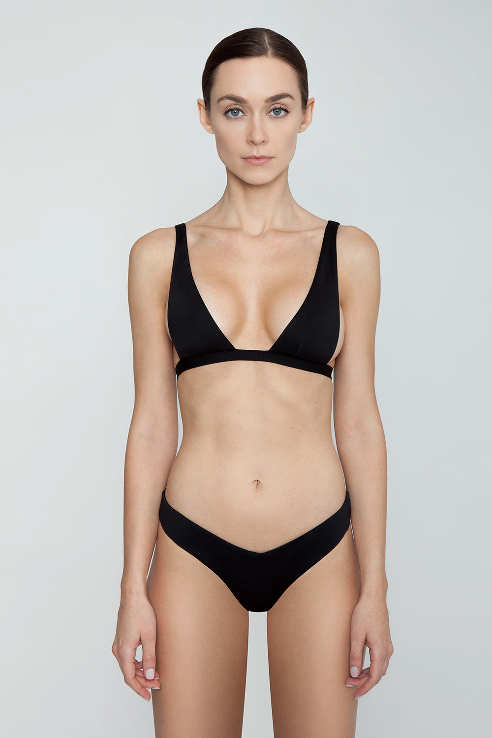 MONICA HANSEN BEACHWEAR Babe Watch Long Triangle Bikini Top - Black Bikini Top | Black| Monica Hansen Babe Watch Long Triangle Bikini Top - Black. Plunging U-neckline Long triangle top Small nickel colored metal clasp in back Double fabric on the inside instead of lining Italian fabric 85% Nylon 15% Elastane Manufactured in Italy Hand wash cold.  Dry Flat Front View