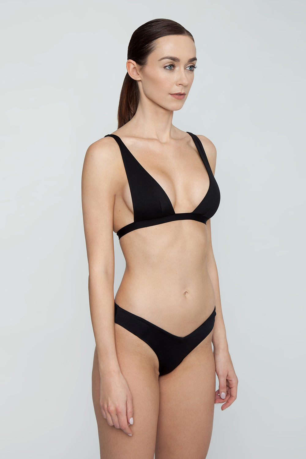 MONICA HANSEN BEACHWEAR Babe Watch Long Triangle Bikini Top - Black Bikini Top | Black| Monica Hansen Babe Watch Long Triangle Bikini Top - Black. Plunging U-neckline Long triangle top Small nickel colored metal clasp in back Double fabric on the inside instead of lining Italian fabric 85% Nylon 15% Elastane Manufactured in Italy Hand wash cold.  Dry Flat Side View