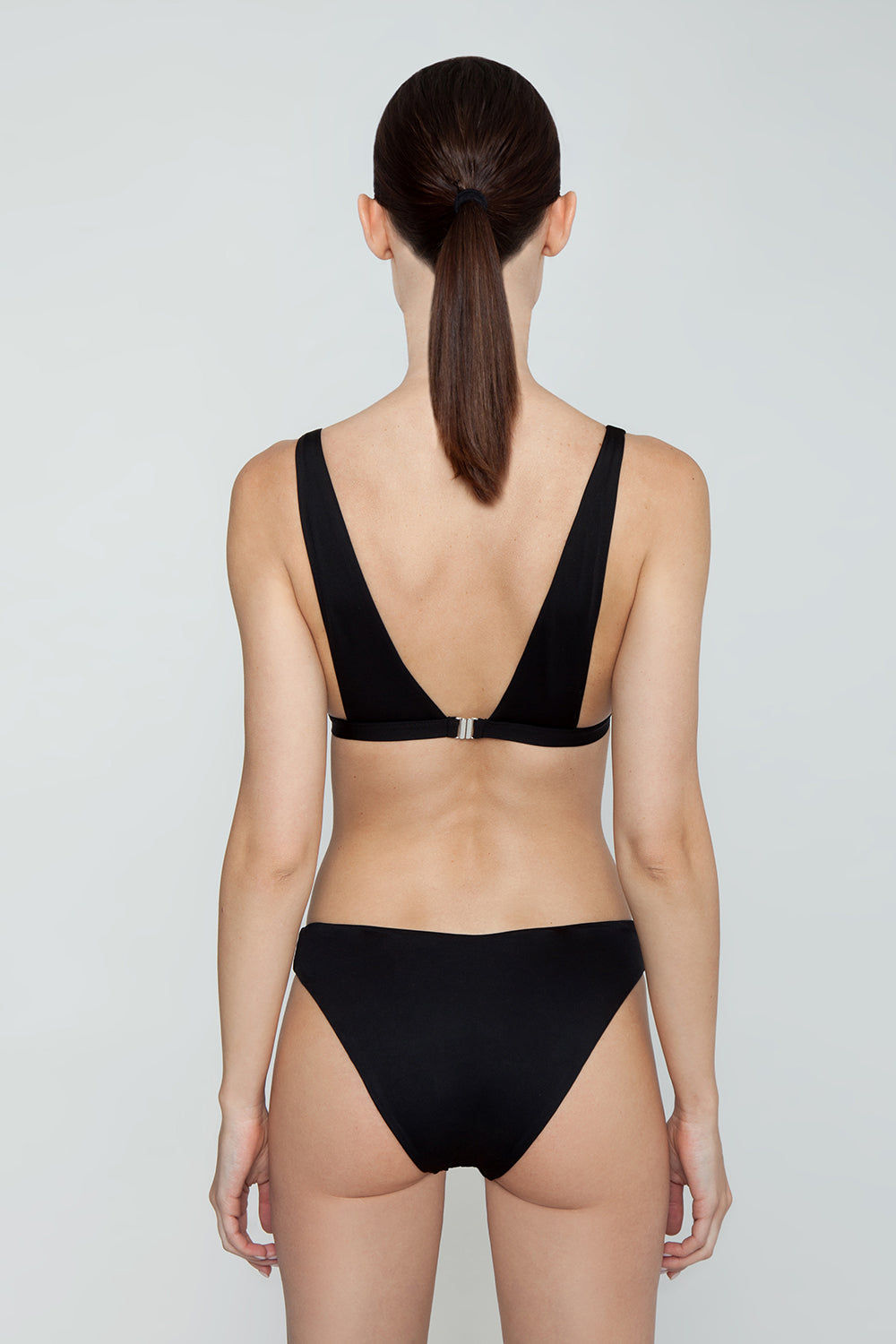 MONICA HANSEN BEACHWEAR Babe Watch Long Triangle Bikini Top - Black Bikini Top | Black| Monica Hansen Babe Watch Long Triangle Bikini Top - Black. Plunging U-neckline Long triangle top Small nickel colored metal clasp in back Double fabric on the inside instead of lining Italian fabric 85% Nylon 15% Elastane Manufactured in Italy Hand wash cold.  Dry Flat Back View