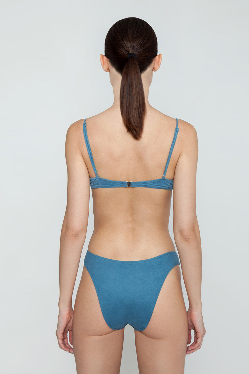 MONICA HANSEN BEACHWEAR Start Me Up Underwire Bikini Top - Blue Bikini Top | Blue| Monica Hansen Beachwear Start Me Up Underwire Bikini Top - Blue. Underwire Adjustable shoulder straps Metal clasp in back Double fabric on the inside instead of lining Italian fabric 85% Nylon 15% Elastane Manufactured in Italy Hand wash cold.  Dry flat Back View