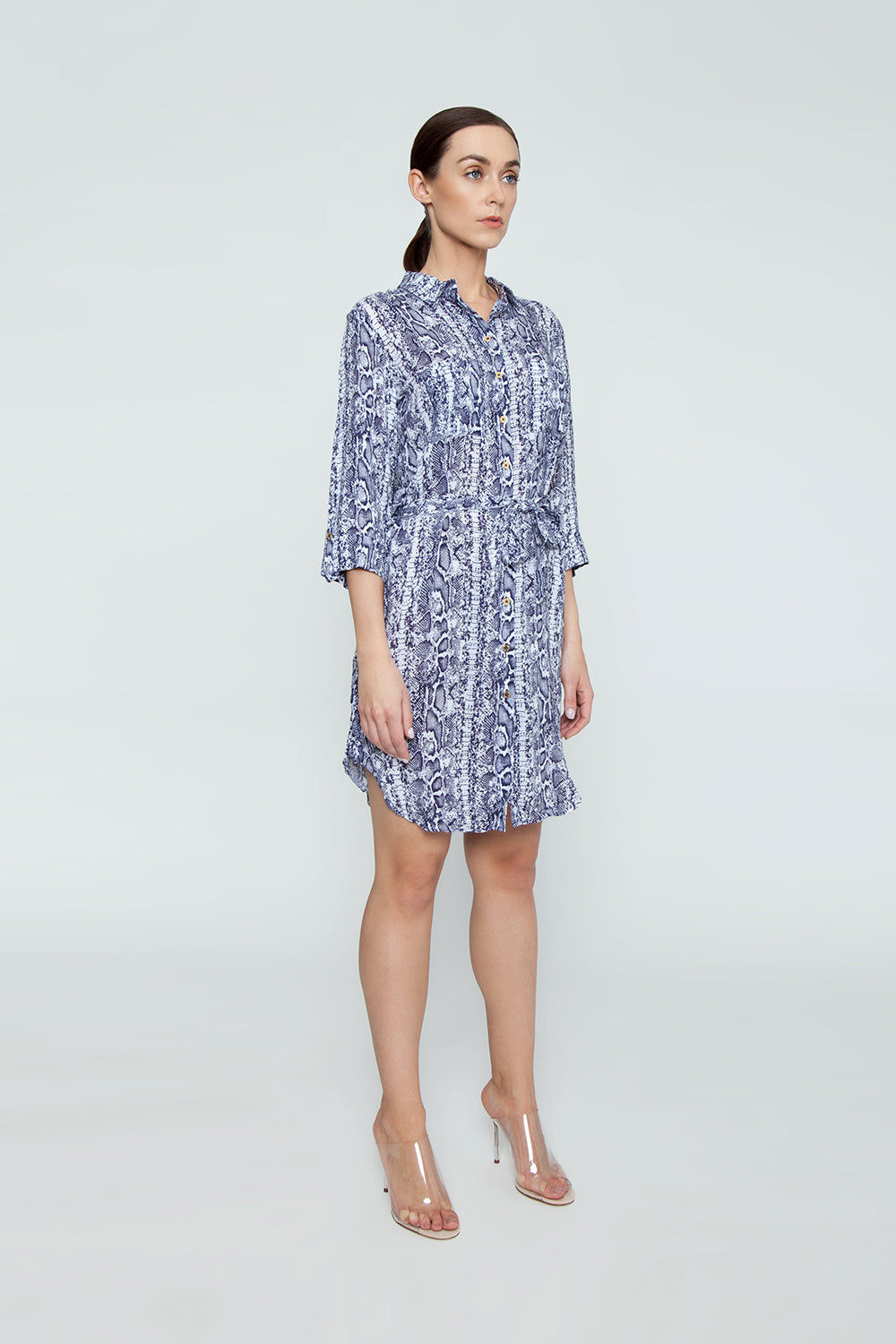 HEIDI KLEIN Relaxed Button Up Shirt Mini Dress - Blue Animal Print Dress | Blue Animal Print| Relaxed Button Up Shirt Mini Dress - Blue Animal Print Features:  A rounded hem that dips at the back and a drawstring for an adjustable fit and a flattering silhouette. Neat fitting on the shoulders with slightly shaped side seams.   Sleeves can be worn long or tacked up with sleeve tabs for versatility. Front View