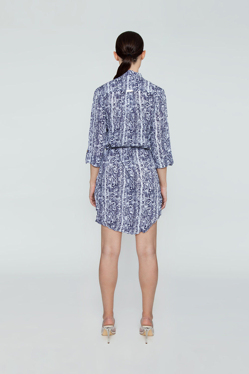HEIDI KLEIN Relaxed Button Up Shirt Mini Dress - Blue Animal Print Dress | Blue Animal Print| Relaxed Button Up Shirt Mini Dress - Blue Animal Print Features:  A rounded hem that dips at the back and a drawstring for an adjustable fit and a flattering silhouette. Neat fitting on the shoulders with slightly shaped side seams.   Sleeves can be worn long or tacked up with sleeve tabs for versatility. Back View