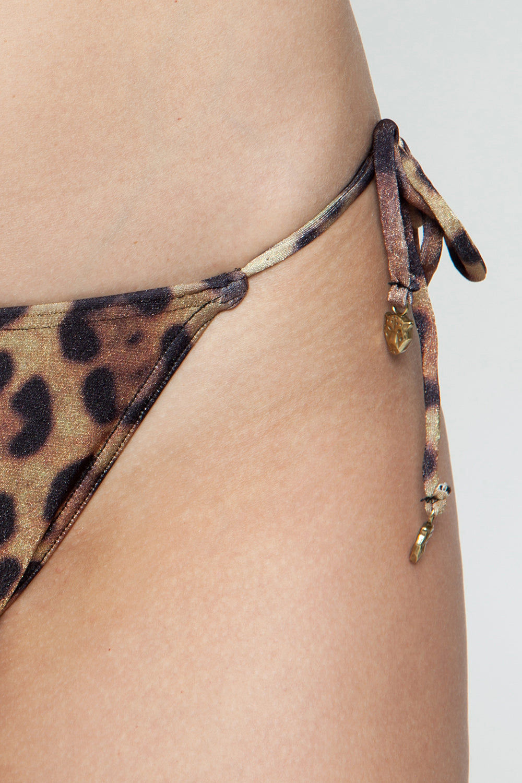 ROSA CHA Bossa Nova Tie Side Bikini Bottom - Leopard Bikini Bottom | Leopard| Rosa Cha Bossa Nova Tie Side Bikini Bottom - Leopard Tie Side Bikini Bottom  Cheeky Coverage Leopard Print 85.5% Polyamide 14.5% Elastane / Lining: 84% Polyamide 16% Elastane Detail View