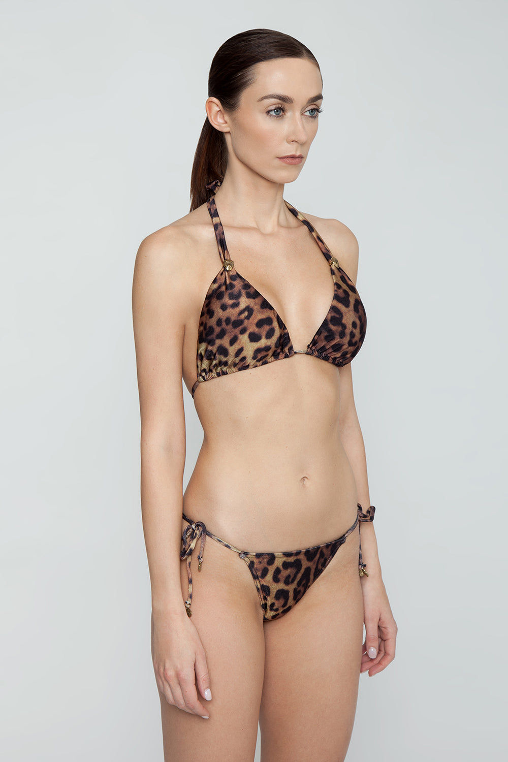 ROSA CHA Carla Strappy Triangle Bikini Top - Leopard Animal Print Bikini Top | Leopard Animal Print| Rosa Cha Carla Strappy Triangle Bikini Top - Leopard Animal Print Fabulous leopard print triangle bikini top with gold leopard head detail. Elegant leopard printed swim fabric will have you dreaming of romantic hideaways and secret beaches on far-off shores.Front View