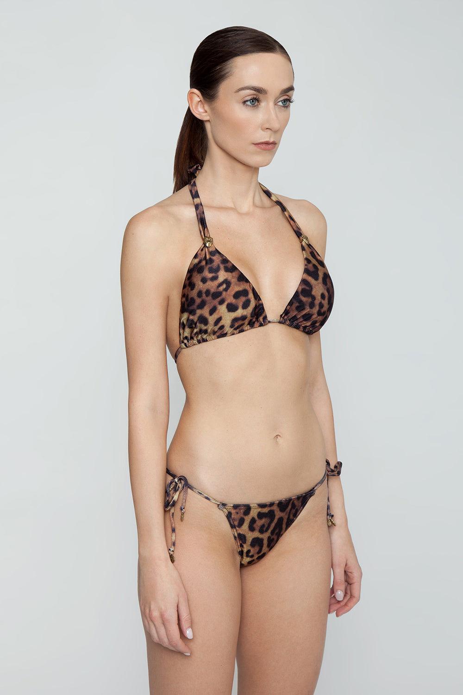 ROSA CHA Bossa Nova Tie Side Bikini Bottom - Leopard Bikini Bottom | Leopard| Rosa Cha Bossa Nova Tie Side Bikini Bottom - Leopard Tie Side Bikini Bottom  Cheeky Coverage Leopard Print 85.5% Polyamide 14.5% Elastane / Lining: 84% Polyamide 16% Elastane Side View