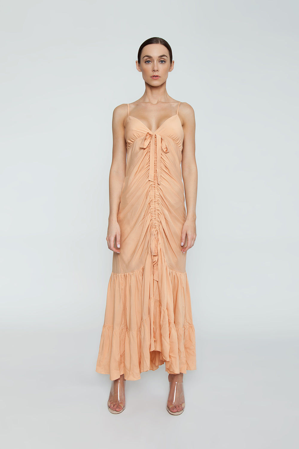 CLUBE BOSSA De Niro Drawstring Long Dress - Peach Dress | Peach| Clube Bossa De Niro Drawstring Long Dress - Peach Features:  V neckline  Thin shoulder straps  Drawstring front scrunch tie closure  Ruffle tier detail  Front View