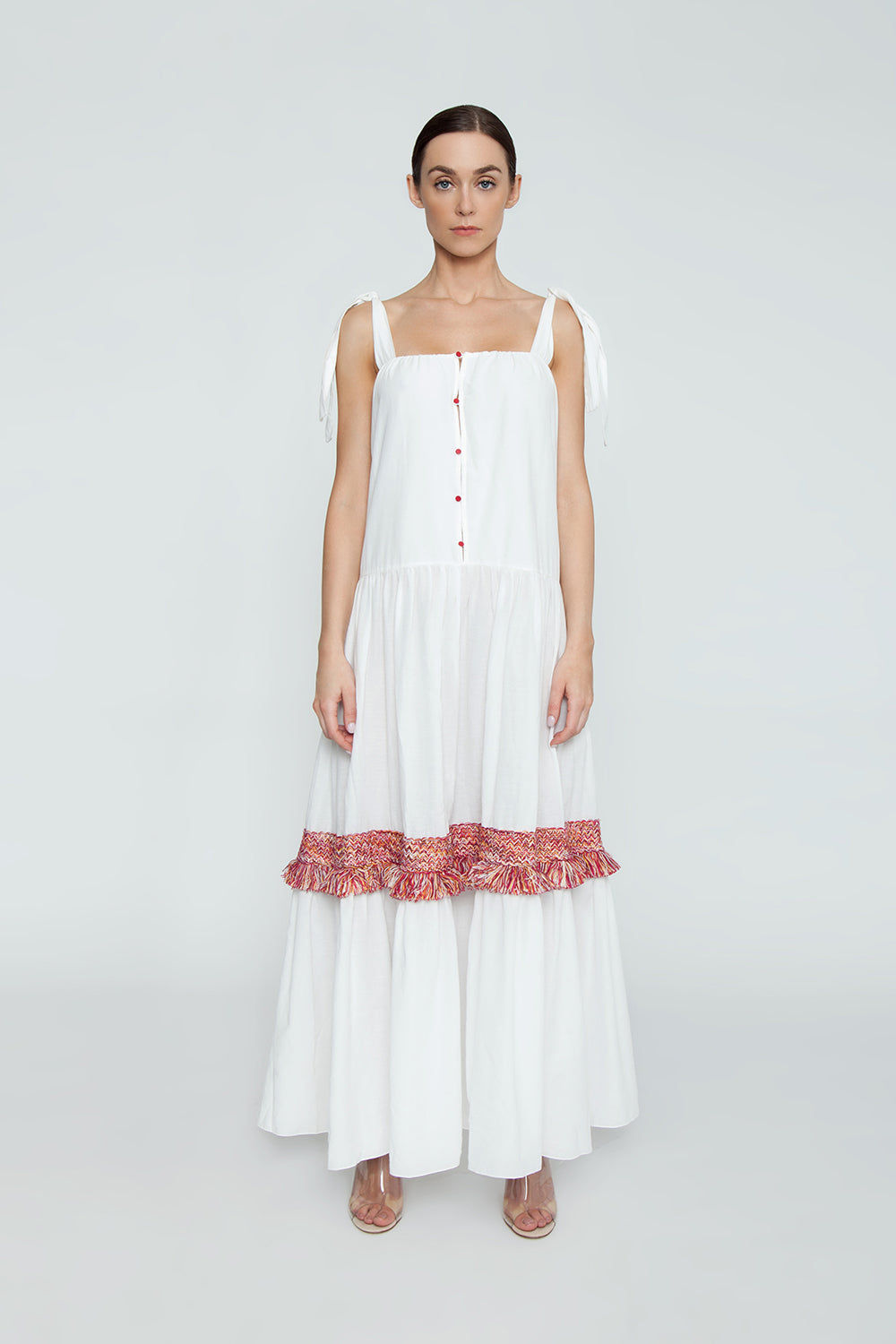 CLUBE BOSSA Bolkan Shoulder Tie Long Dress -  White & Jazzy Fringes Red Dress | White & Jazzy Fringes Red| CLUBE BOSSA Bolkan Shoulder Tie Long Dress - White & Jazzy Fringes Red Features:  Square neckline white long dress Shoulder tie straps Buttoned design Loose fit Front View