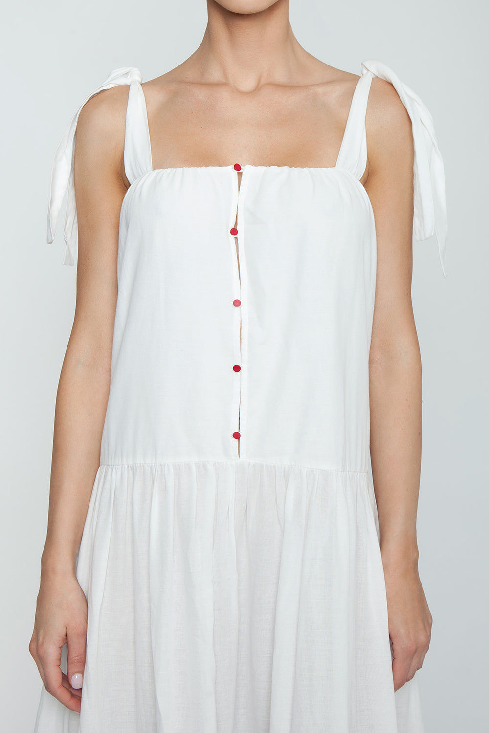 CLUBE BOSSA Bolkan Shoulder Tie Button Front Maxi Dress -  White & Jazzy Fringes Red Dress | White & Jazzy Fringes Red| Clube Bossa Bolkan Shoulder Tie Button Front Maxi Dress -  White & Jazzy Fringes Red Features:  Square neckline white long dress Shoulder tie straps Buttoned design Loose fit Front View