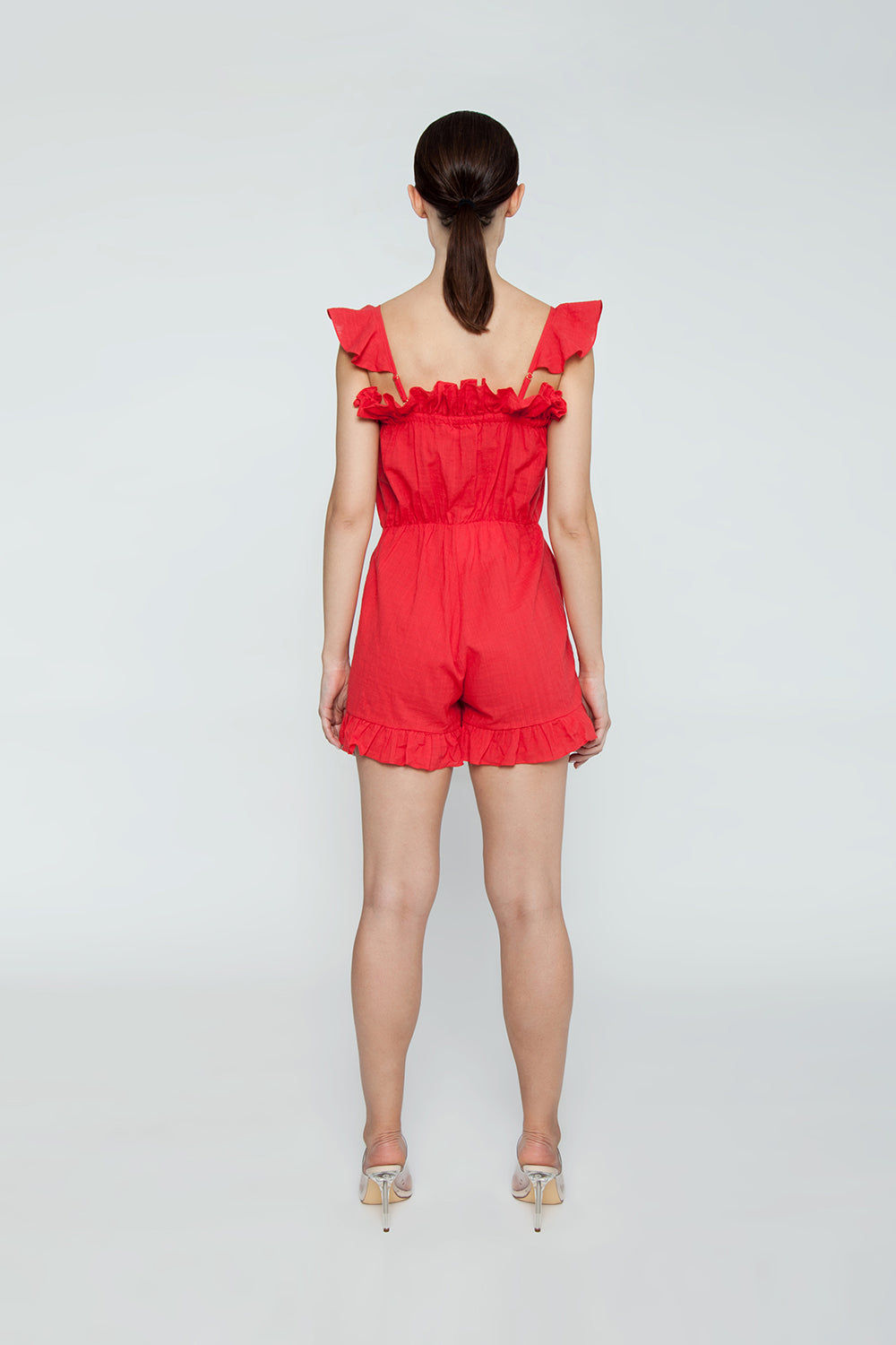 CLUBE BOSSA Follina Ruffle Romper - Pepper Red Romper | Pepper Red| Clube Bossa Follina Ruffle Romper - Pepper Red Ruffle romper Straight neckline  Ruffle sleeves Ruffle front detail  Front button closure  Back View