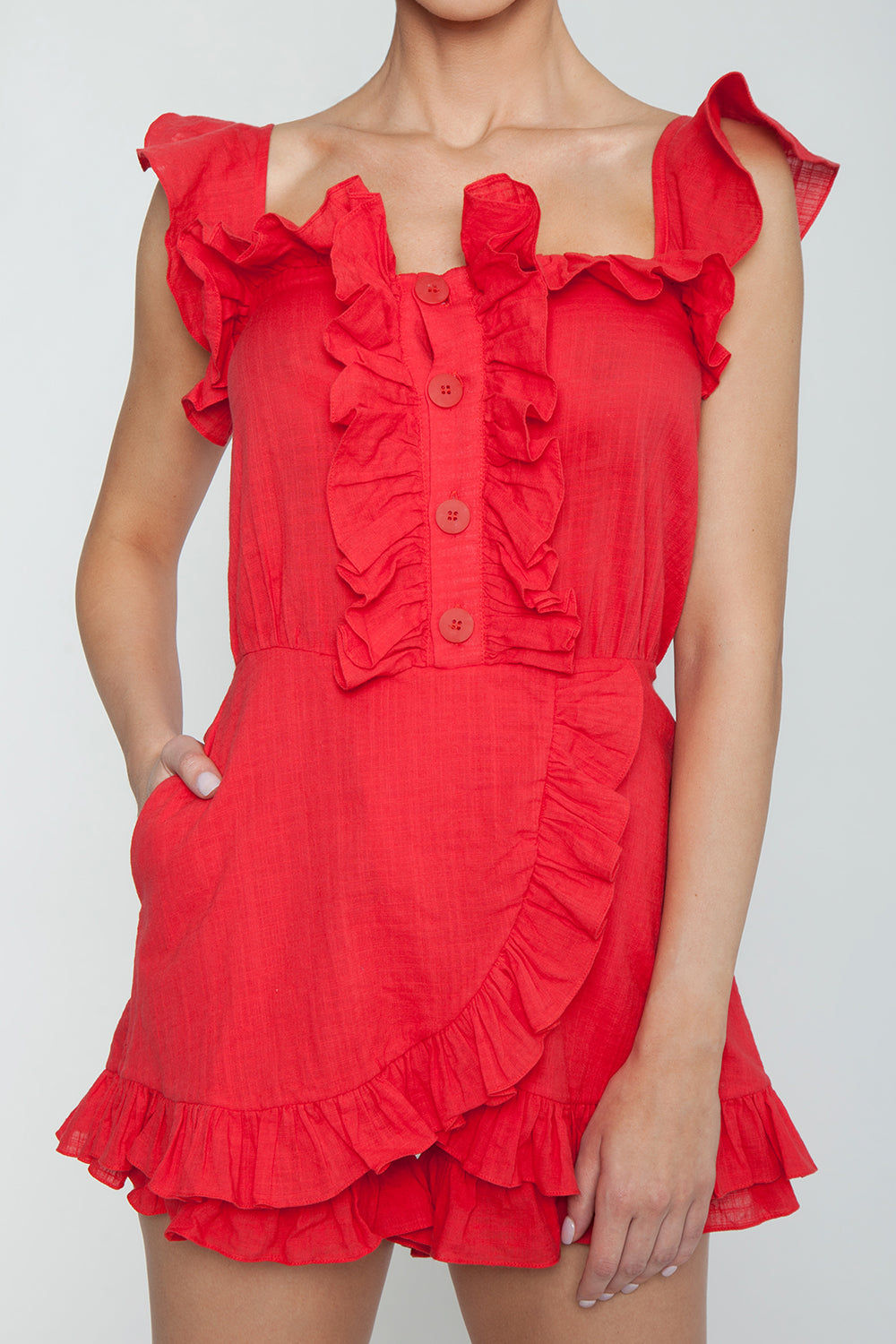 CLUBE BOSSA Follina Ruffle Romper - Pepper Red Romper | Pepper Red| Clube Bossa Follina Ruffle Romper - Pepper Red Ruffle romper Straight neckline  Ruffle sleeves Ruffle front detail  Front button closure  Detail View