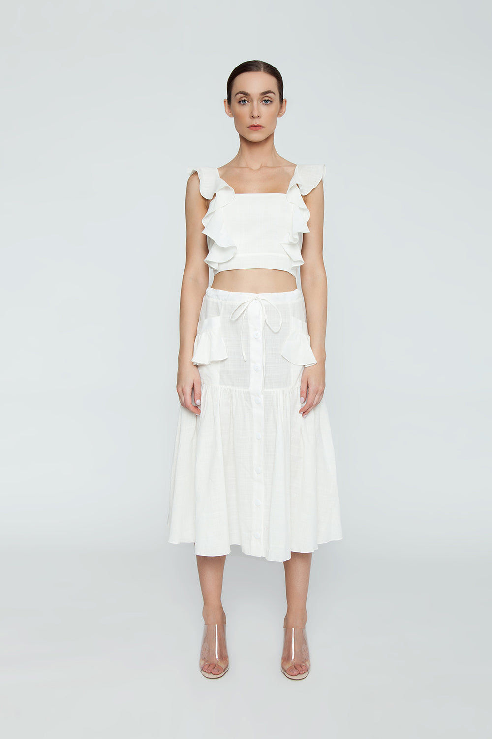 CLUBE BOSSA Lubba Cropped Blouse - Off White Top   Off White  Clube Bossa Lubba Cropped Blouse - Off White Features:  Square neckline Ruffle shoulders Back lace-up fastening 100% Cotton Front View