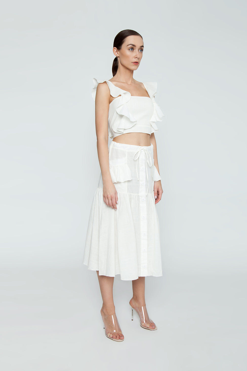 CLUBE BOSSA Lubba Cropped Blouse - Off White Top   Off White  Clube Bossa Lubba Cropped Blouse - Off White Features:  Square neckline Ruffle shoulders Back lace-up fastening 100% Cotton Side View