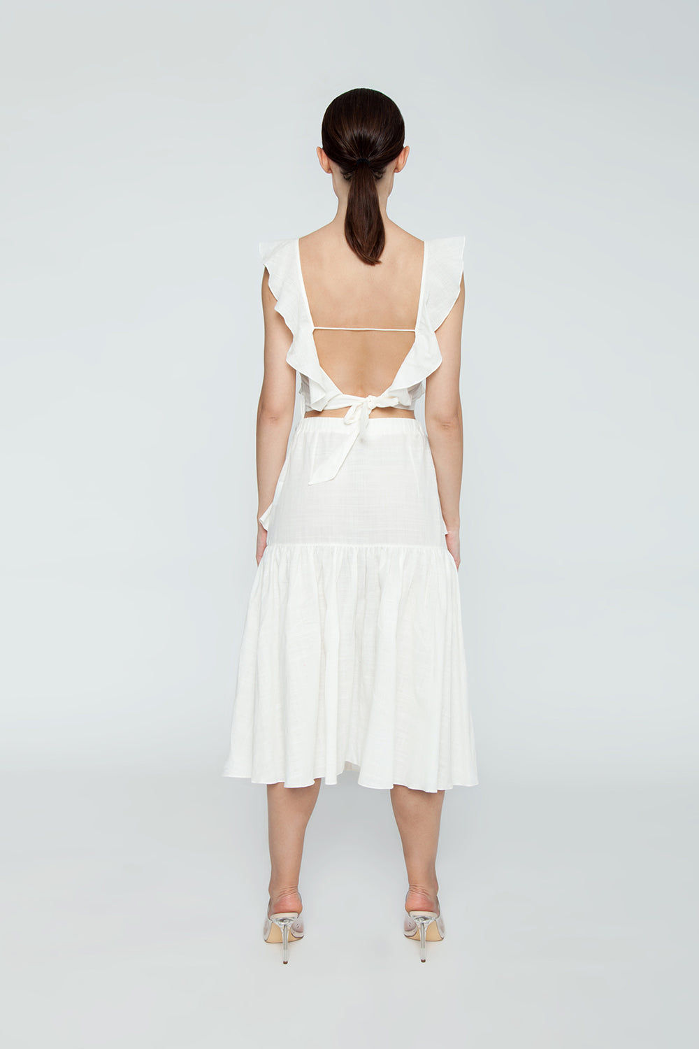 CLUBE BOSSA Lubba Cropped Blouse - Off White Top   Off White  Clube Bossa Lubba Cropped Blouse - Off White Features:  Square neckline Ruffle shoulders Back lace-up fastening 100% Cotton Back View