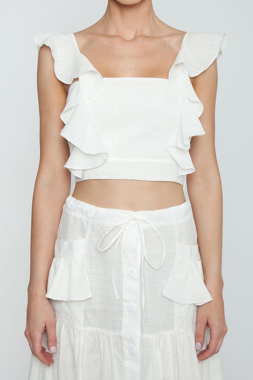CLUBE BOSSA Fara High Waist Midi Skirt - Off White Skirt | Off White| Clube Bossa Fara High Waist Midi Skirt - Off White Midi skirt High waist Front tie closure Front button closure Ruffle side detail Detail View