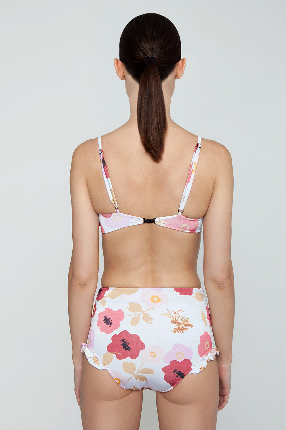 CLUBE BOSSA Brigida High Waist Bikini Bottom - Pepper La Beija Floral Print Bikini Bottom | Pepper La Beija Floral Print| CLUBE BOSSA Brigida High Waist Bikini Bottom - Pepper La Beija Floral Print. Features:  High waist bikini bottom Ruffle edges Elastic waistband Floral print Back View
