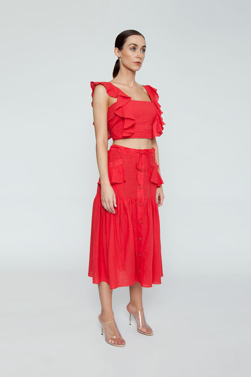 CLUBE BOSSA Fara High Waist Midi Skirt - Pepper Red Skirt | Pepper Red| Clube Bossa Fara High Waist Midi Skirt - Pepper Red. Features:  Midi red skirt Mid rise Drawstring waist Side pockets Front button fastening Ruched detail Loose fit Side View