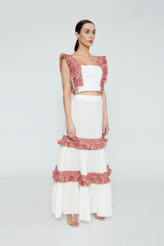 CLUBE BOSSA Pisan Long Fringe Skirt - White & Jazzy Fringes Red Skirt | White & Jazzy Fringes Red| Clube Bossa Pisan Long Fringe Skirt - White & Jazzy Fringes Red Long layered maxi skirt in white with warm-toned fringe tier detail. The bold red and yellow toned fringe pops off the contrasting clean white of this skirt. The high waisted Side View