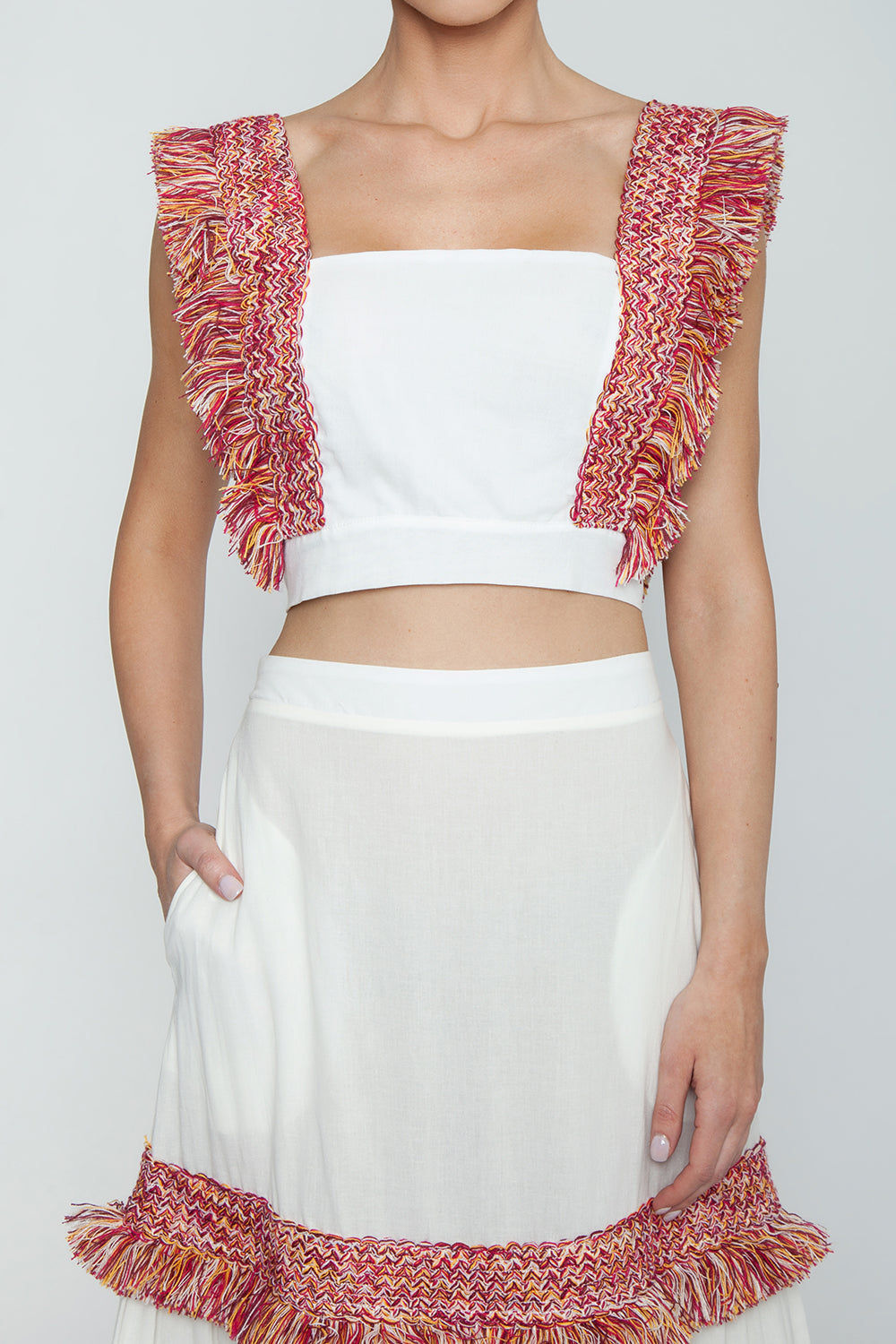 CLUBE BOSSA Pisan Long Fringe Skirt - White & Jazzy Fringes Red Skirt | White & Jazzy Fringes Red| Clube Bossa Pisan Long Fringe Skirt - White & Jazzy Fringes Red Long layered maxi skirt in white with warm-toned fringe tier detail. The bold red and yellow toned fringe pops off the contrasting clean white of this skirt. The high waisted Detail View