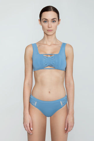 CLUBE BOSSA Sober Weaving Bralette Bikini Top - Riviera Blue Bikini Top | Riviera Blue| Clube Bossa Sober Weaving Bralette Bikini Top - Riviera Blue Features:  Bralette  Front cut out detail Center weaving detail Thick shoulder straps Front View