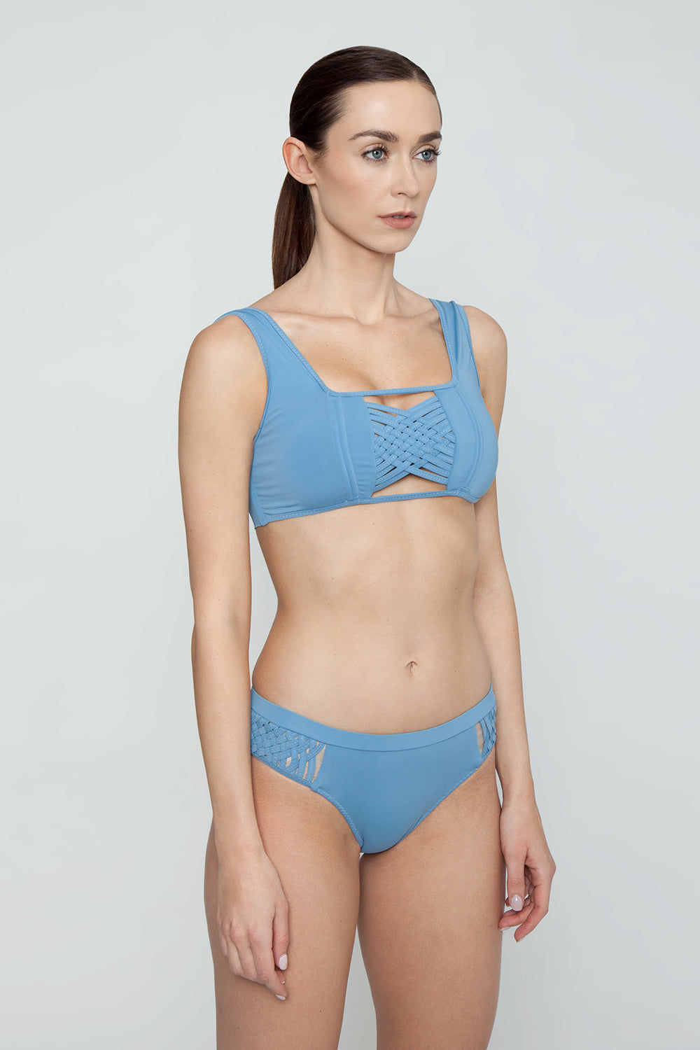 CLUBE BOSSA Sober Weaving Bralette Bikini Top - Riviera Blue Bikini Top | Riviera Blue| Clube Bossa Sober Weaving Bralette Bikini Top - Riviera Blue Features:  Bralette  Front cut out detail Center weaving detail Thick shoulder straps Side View