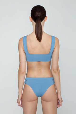 CLUBE BOSSA Perle Weaving Hipster Bikini Bottom - Riviera Blue Bikini Bottom | Riviera Blue| Clube Bossa Perle Weaving Hipster Bikini Bottom - Riviera Blue Features:  Hipster  Cheeky-moderate coverage  Side weaving detail Back View