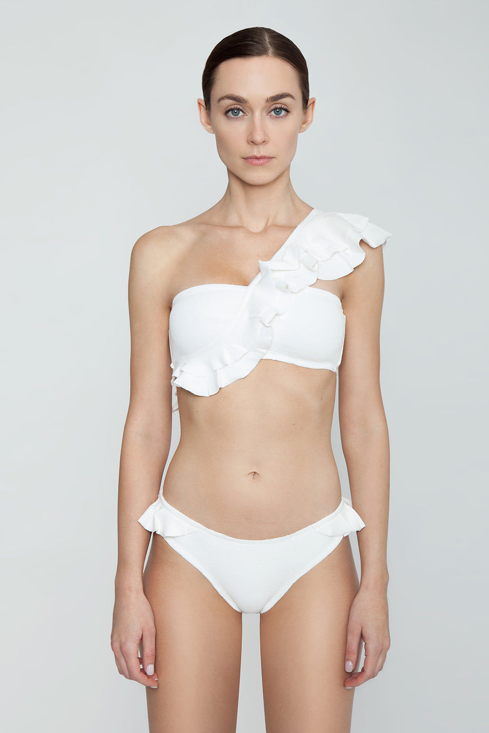 CLUBE BOSSA Malgosia Ruffle One Shoulder Bikini Top - Off White Bikini Top | Off White| Clube Bossa Malgosia Ruffle One Shoulder Bikini Top - Off White Asymmetric one shoulder strap  Ruffle detail Straight neckline Front View