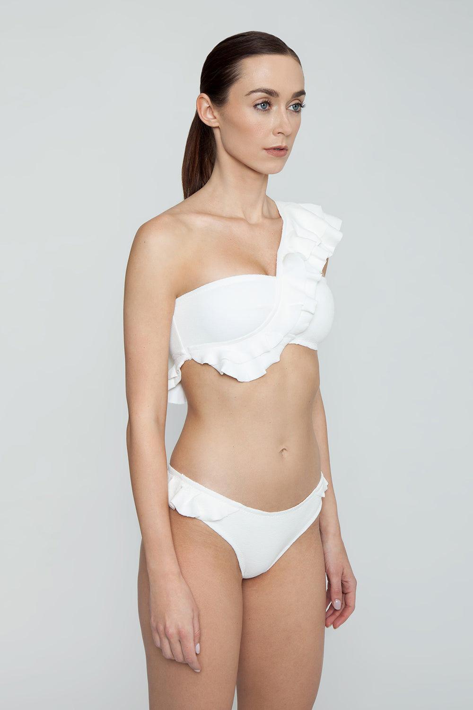 CLUBE BOSSA Laven Ruffle Cheeky Bikini Bottom - Off White Bikini Bottom | Off White| Clube Bossa Laven Ruffle Cheeky Bikini Bottom - Off White Hipster  Side ruffle detail Cheeky coverage  Side View