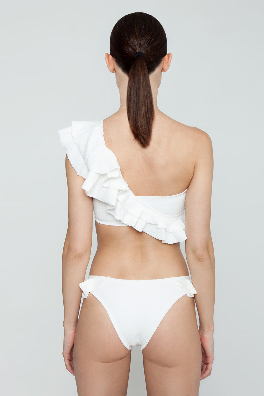 CLUBE BOSSA Laven Ruffle Cheeky Bikini Bottom - Off White Bikini Bottom | Off White| Clube Bossa Laven Ruffle Cheeky Bikini Bottom - Off White Hipster  Side ruffle detail Cheeky coverage  Back View