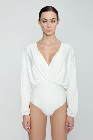 AGUA DE COCO Brazilian Long Sleeves One Piece Swimsuit - Off White One Piece | Off White| Agua De Coco Brazilian Long Sleeves One Piece Swimsuit - Off White White one piece Plunging v neckline Gathered fabric  Long sleeves  Open back detail  Cheeky - moderate coverage Front View