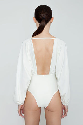 AGUA DE COCO Brazilian Long Sleeves One Piece Swimsuit - Off White One Piece | Off White| Agua De Coco Brazilian Long Sleeves One Piece Swimsuit - Off White White one piece Plunging v neckline Gathered fabric  Long sleeves  Open back detail  Cheeky - moderate coverage Back View
