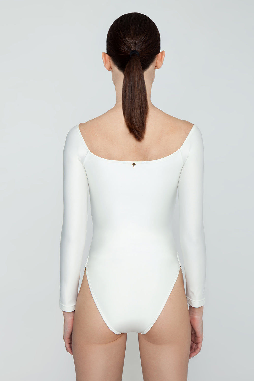 AGUA DE COCO Brazilian Off Shoulder Side Detail One Piece Swimsuit - Off White One Piece | Off White| Agua De Coco Brazilian Off Shoulder Side Detail One Piece Swimsuit - Off White White one piece Off shoulder Long sleeves  Side ring hardware detail  Cheeky - moderate coverage Back View