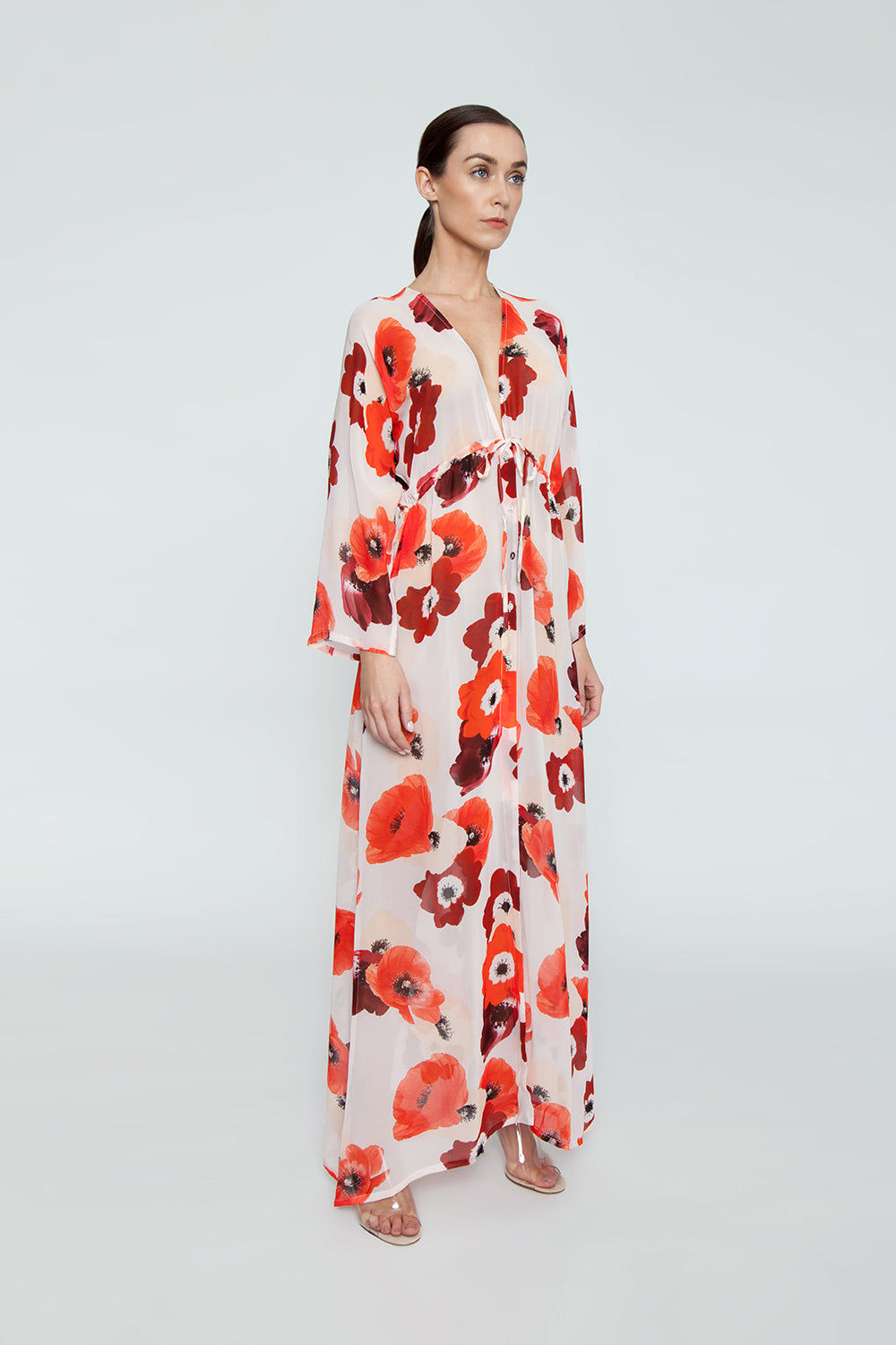 EVARAE Gela Open Kimono - Red Poppy Print Dress | Red Poppy Print| Evarae Gela Open Kimono - Red Poppy Print. Features:  100% Silk Georgette Slightly sheer Can be worn open or pulled in by adjustable cords at the waist Side View