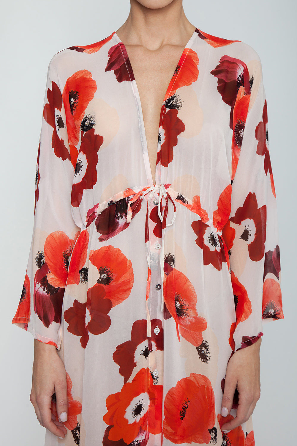 EVARAE Gela Open Kimono - Red Poppy Print Dress | Red Poppy Print| Evarae Gela Open Kimono - Red Poppy Print. Features:  100% Silk Georgette Slightly sheer Can be worn open or pulled in by adjustable cords at the waist Detail View