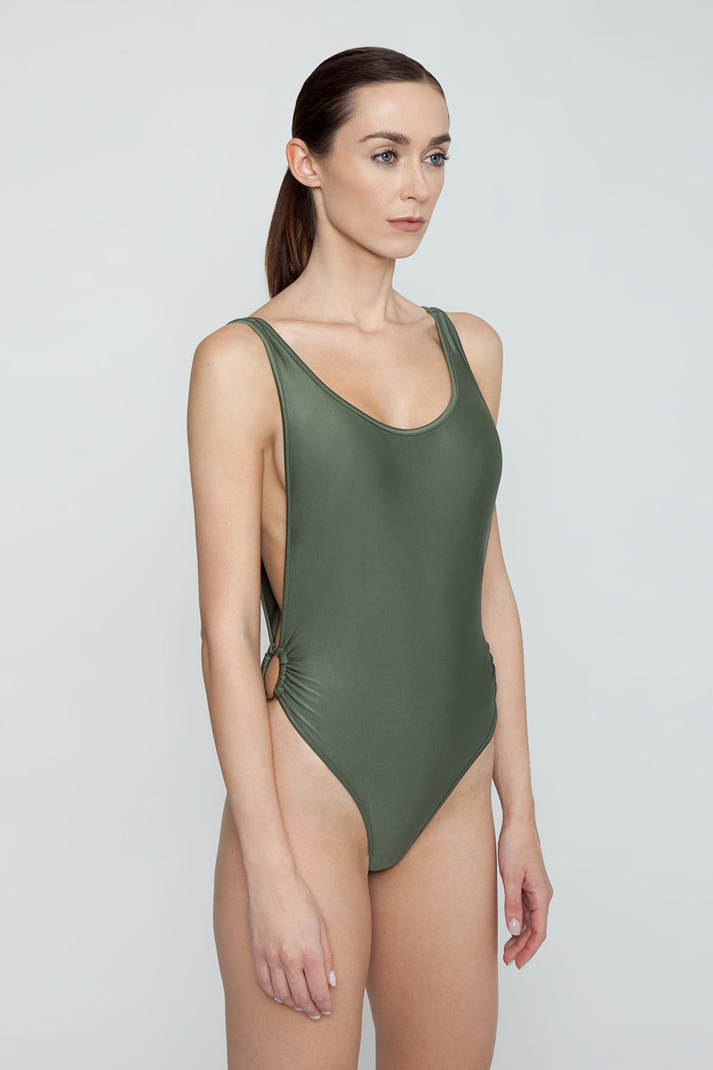 AGUA DE COCO Brazilian Cut Out Ring Sides One Piece Swimsuit - Olive Green One Piece | Olive Green| Agua De Coco Brazilian Cut Out Ring Sides One Piece Swimsuit - Olive Green Green one piece Scoop neckline  Side boob exposure  High cut leg  Side ring hardware detail  Moderate coverage  Side View