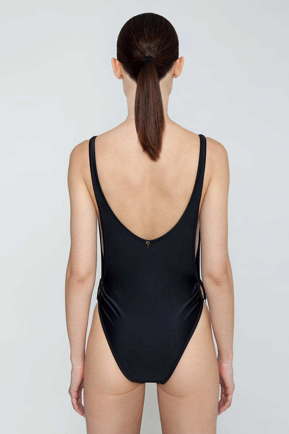 AGUA DE COCO Brazilian Cut Out Ring Sides One Piece Swimsuit - Black One Piece | Black| Agua De Coco Brazilian Cut Out Ring Sides One Piece Swimsuit - Black Black one piece Scoop neckline  Side boob exposure  High cut leg  Side ring hardware detail  Cheeky coverage Back View