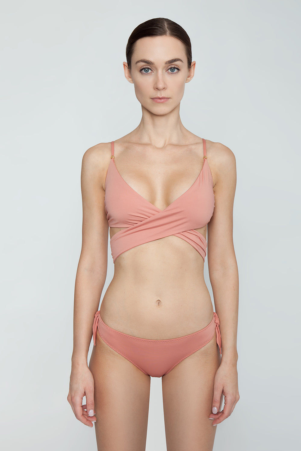 STELLA MCCARTNEY Wrap Bikini Top - Antique Rose Pink Bikini Top | Antique Rose Pink| Stella McCartney Wrap Bikini Top - Antique Rose Pink Figure-flattering true wrap bikini top in pretty dusty rose color. Soft unpadded triangle cups criss-cross below bust and tie at mid-back in a chunky feminine bow. Boned sides with slight ruching detail subtly sculpt and flatter the bust without the need for padding or underwire. Front View