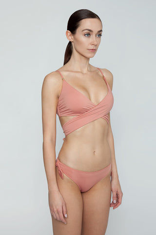 STELLA MCCARTNEY Wrap Bikini Top - Antique Rose Pink Bikini Top | Antique Rose Pink| Stella McCartney Wrap Bikini Top - Antique Rose Pink Figure-flattering true wrap bikini top in pretty dusty rose color. Soft unpadded triangle cups criss-cross below bust and tie at mid-back in a chunky feminine bow. Boned sides with slight ruching detail subtly sculpt and flatter the bust without the need for padding or underwire. Side View