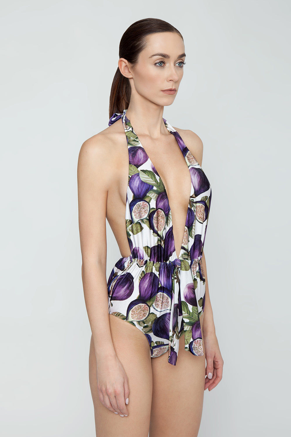 ADRIANA DEGREAS Plunging Halter Neck One Piece Swimsuit - Fig Purple Print One Piece   Fig Purple Print  Adriana Degreas Knotted Halter Neck One Piece Swimsuit - Fig Purple Print. Features:  Plunging neckline Adjustable halter neck ties Pin-up styles from 1950s Cut from soft stretch fabric Medium coverage   Side view