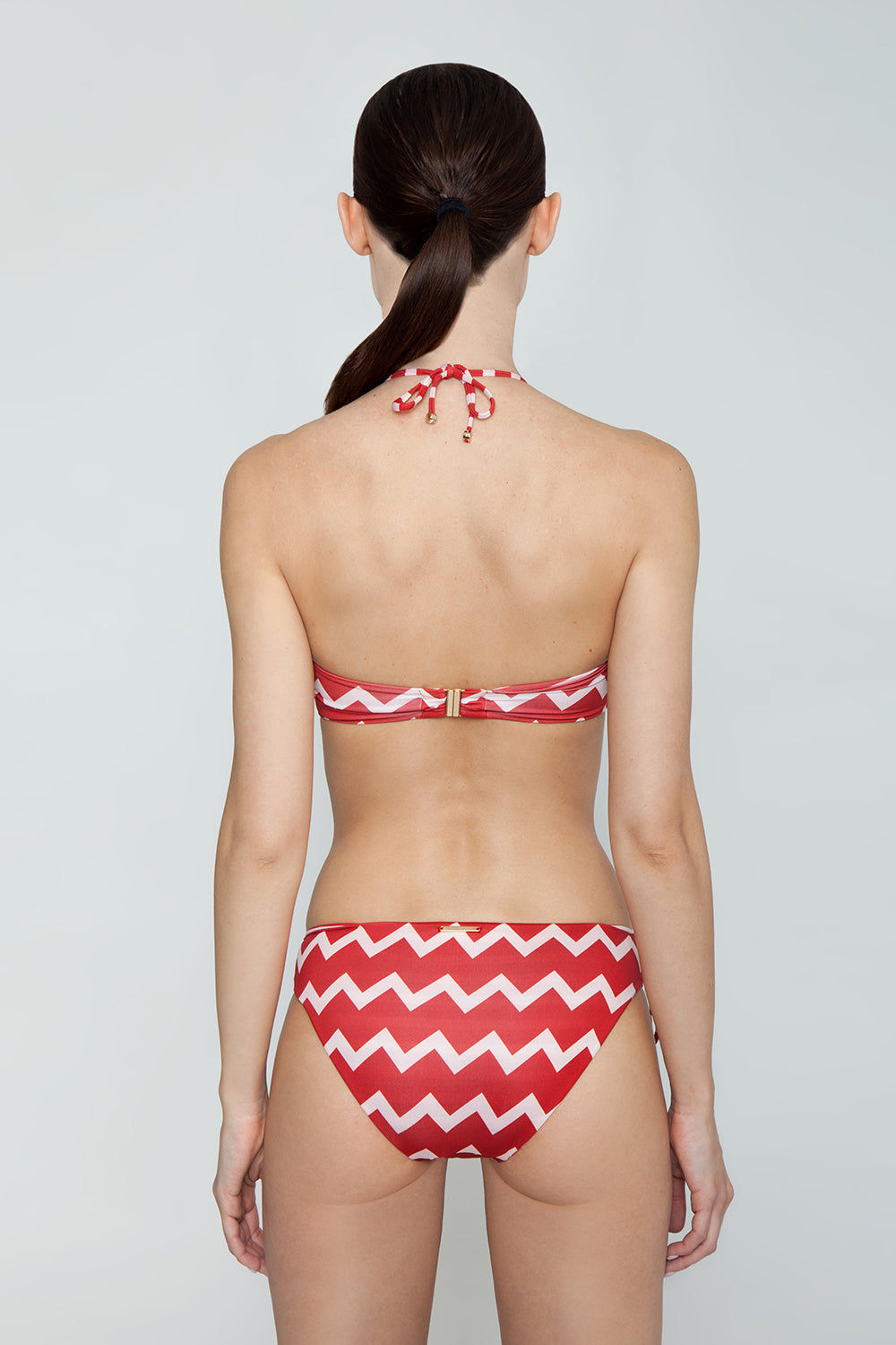 STELLA MCCARTNEY Zig-Zag Bandeau Ring Bikini Top - Red/Cream Chevron Print Bikini Top | Red/Cream Chevron Print| Stella McCartney Bandeau Ring Cut Out Bikini Top - Red/Cream Chevron Print Features:   Bandeau style  Ring cut out  Halter neck strap Back View