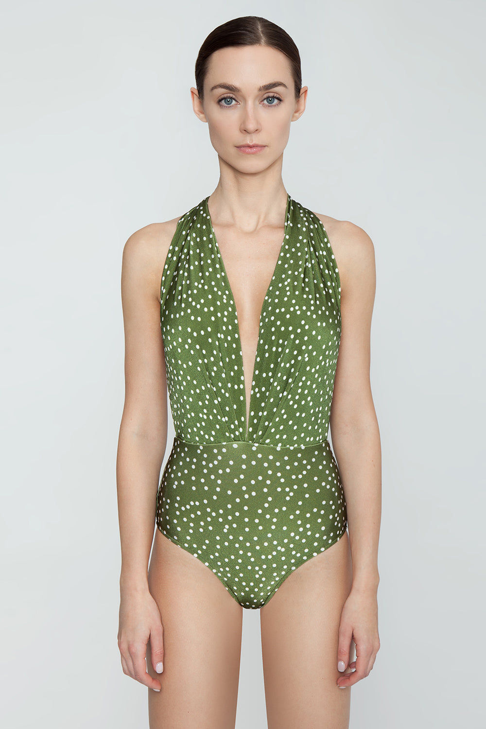 ADRIANA DEGREAS Plunging Halter Neck One Piece Swimsuit - Mille Punti Army Green Polka Dot Print One Piece | Mille Punti Army Green Polka Dot Print| ADRIANA DEGREAS Plunging Halter Neck One Piece Swimsuit - Mille Punti Army Green Polka Dot Print Plunging halter neck one piece swimsuit in army green polka dot print. Inspired by 1950s pin-up style, the halter neckline features flattering pleats and extra coverage at underarms. Fixed halter strap connects behind neck to wide draped straps Front View