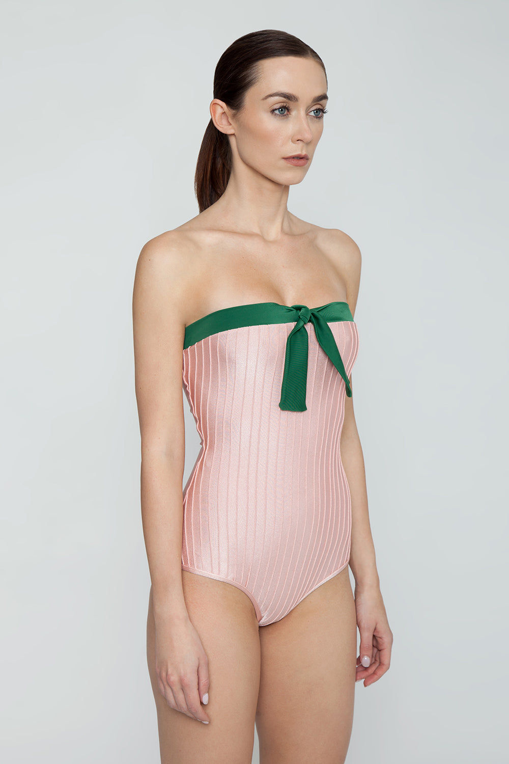ADRIANA DEGREAS Strapless One Piece Swimsuit - Bicolor Light Pink/Emerald Green One Piece | Bicolor Light Pink/Emerald Green| Adriana Degreas Bicolor Strapless One Piece Swimsuit - Light Pink/Emerald Green. Features:  Strapless swimsuit with front knot detail. The strapless swimsuit is perfect for those who want to avoid tan lines. Main: 84% Polyamide 16% Spandex. Side View