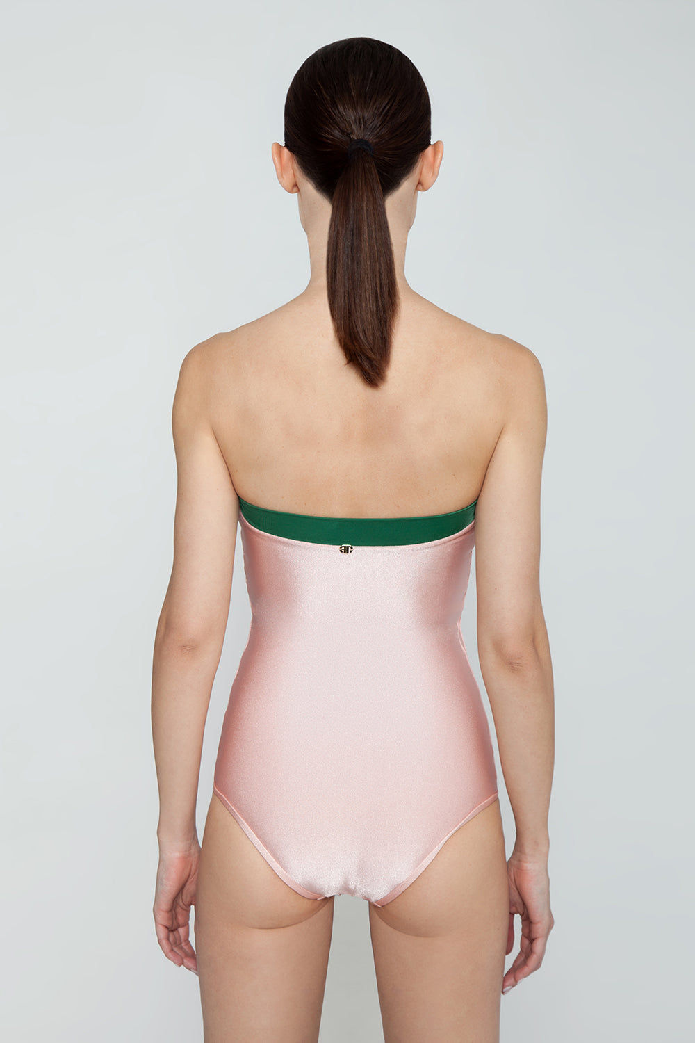 ADRIANA DEGREAS Strapless One Piece Swimsuit - Bicolor Light Pink/Emerald Green One Piece | Bicolor Light Pink/Emerald Green| Adriana Degreas Bicolor Strapless One Piece Swimsuit - Light Pink/Emerald Green. Features:  Strapless swimsuit with front knot detail. The strapless swimsuit is perfect for those who want to avoid tan lines. Main: 84% Polyamide 16% Spandex. Back View