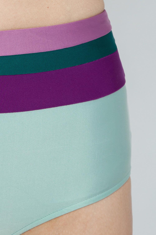 ADRIANA DEGREAS Hot High Waist Bikini Bottom - Mint/Green/Purple/Lilac Color Block Bikini Bottom | Mint/Green/Purple/Lilac Color Block| Adriana Degreas Hot Color Block High Waist Bikini Bottom - Light Blue/Green/Purple/Lilac. Features:  High-rise bikini bottom Medium coverage Main: 84% polyamide, 16% spandex. Detail View